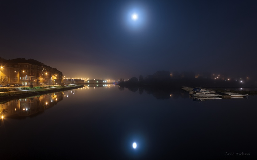 Moon over waterside