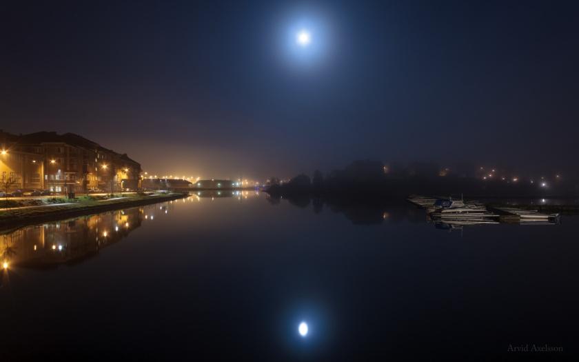 Moon over waterside